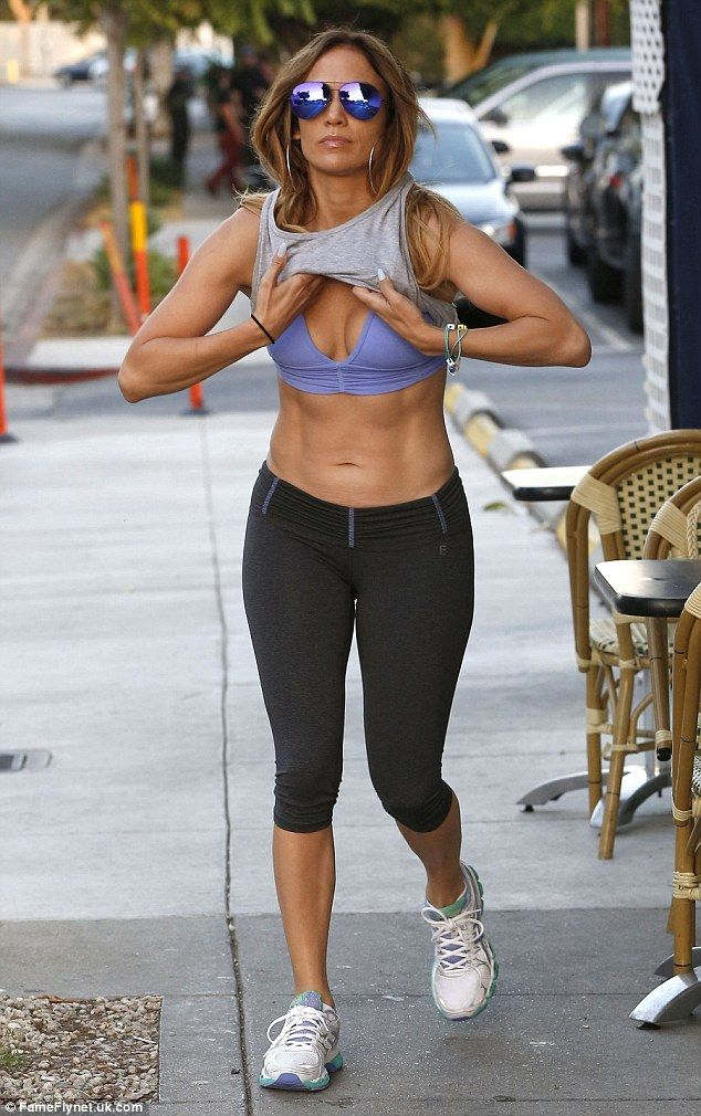 Fabulous figure: Jennifer Lopez flashed her sculpted abs as she got changed following a workout in West Hollywood on Thursday afternoon