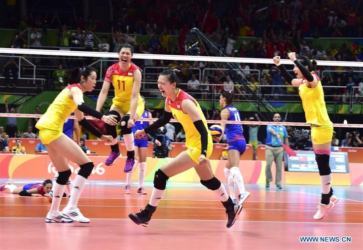 China's players celebrate after the women's gold medal match of Volleyball against Serbia at the 2016 Rio Olympic Games in Rio de Janeiro, Brazil, on Aug. 20, 2016. China won the gold medal.   http://www.chinasportsbeat.com/2016/08/china-wins-olympic-womens-volleyball.html