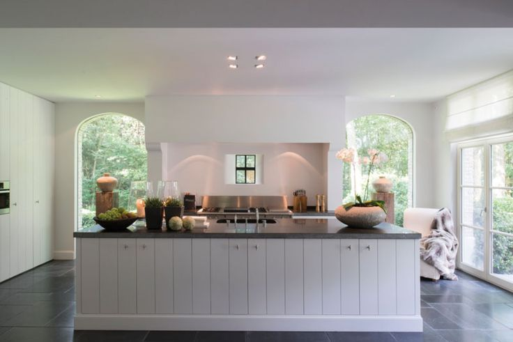Stunning white v groove kitchen with dark counters / benchtops