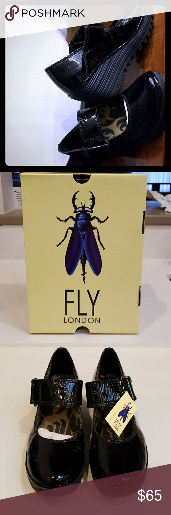 Fly London Wedged Mary Jane shoes UK-based Fly London Yag black leather patent Mary Janes man, made in Portugal, will enhance a closet that has an edgy yet on-point current style platform. 2 1/4 wedge heel will help elevate any whimsical cute outfit. Never worn with original tag and packaging.. Fly London Shoes Wedges