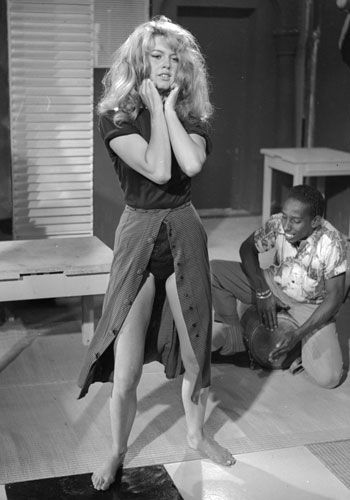 Bridget Bardot in a scene from AND GOD CREATED WOMAN. FACT: This iconic scene, where she dances provocatively in a split skirt, led to the film being condemned by the Catholic League of Decency. #FILMFASHION