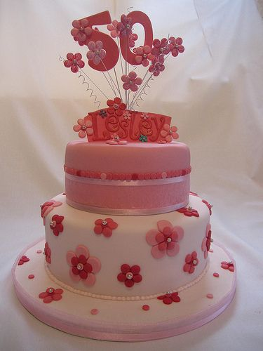 50th Birthday Cake. Tiered and pink fondant flowers