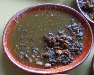 Carne en Jugo (beef in broth) is a specialty of Karne Garibaldi in Guadalajara, Mexico.  You can eat it like a soup/stew, or load the meat and an assortment into a taco.  Delicious!