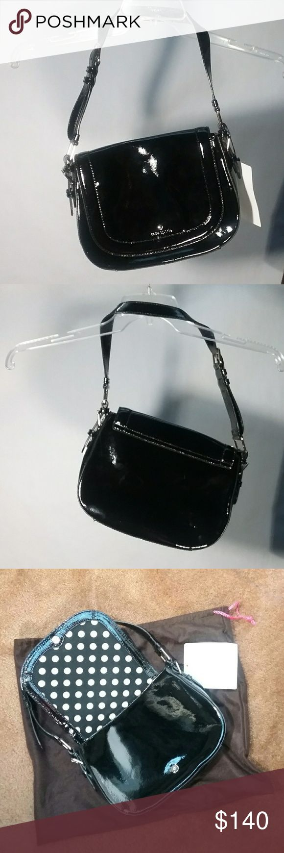 Black kate spade Carlisle Street Piper Preowned from designer consignment shop.Very good condition, clean inside, no stains or smells. I've done my best to inspect & have indicated the minor scratches seen in the pics. The tag was attached by consignment shop to authenticate.  Dustbag included.  A gilded spade charm & logo adorn the front flap of a proper patent shoulder bag in a classic silhouette. Magnetic-snap closure.Adjustable strap.Interior zip, wall and cell phone pockets.Patent…