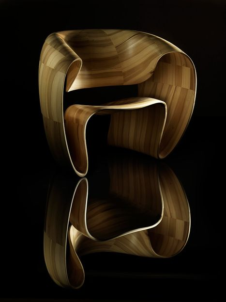 """Ribbon Chair by Tom Vaughan    The no-assembly-required Ribbon Chair is a machine-sculpted chair made of one continuous """"ribbon"""" of wood."""