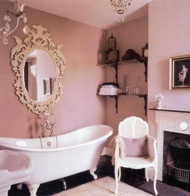 It has it all: claw foot tub, fireplace, chandelier...perfect.