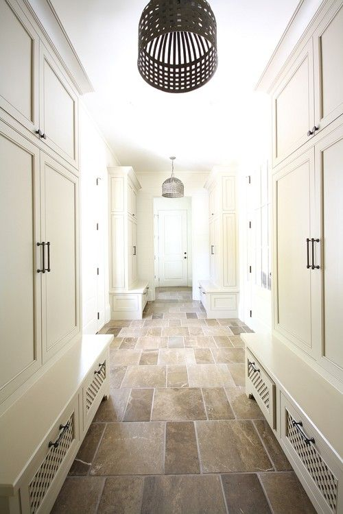 Cabinets are painted Benjamin Moore Timid White. Great elongation created by tile orientation.