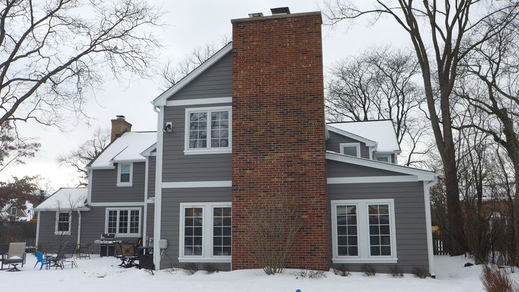 James Hardie Siding in Aged Pewter with Arctic White Trim Certainteed Roofing in Driftwood #homeremodel #exteriors
