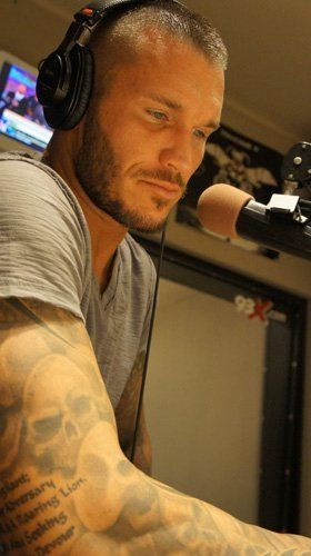 I don't watch wrestling but maybe I SHOULD!!! ..... Randy Orton