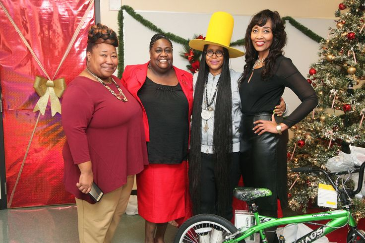 The MLK Center Staff - LaRhonda Bacon, Karen Rayzer and Pamela Jones Take A Group Pic By the Tree… A Huge Thanks from BET and Walmart!