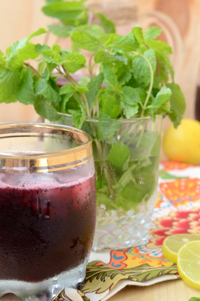Mulberry Lemonade made with fresh mulberries and garnished with mint leaves!