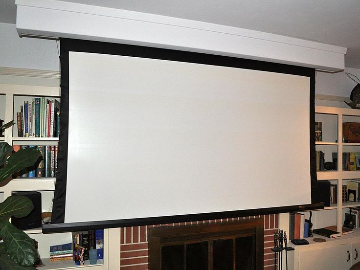 For our next living room roll up screen in from of book shelves projector space saver city for Hiding a projector in living room