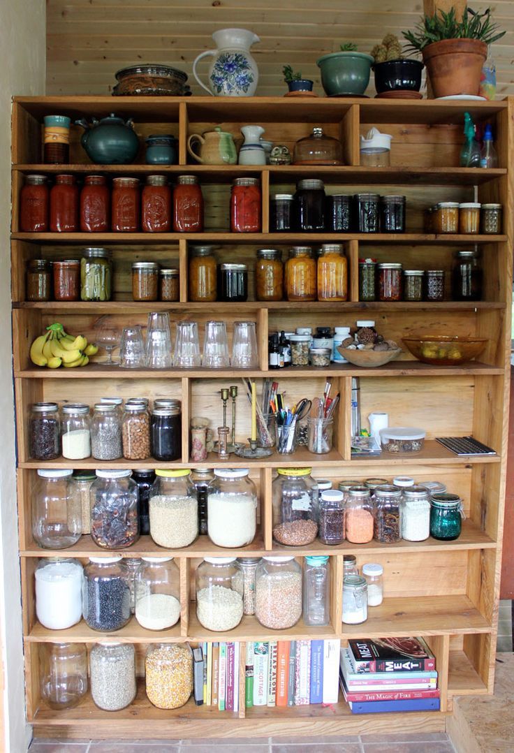 """One wall. Repurposed pieces of oak and elm, were sanded and finished with Heritage brand natural oil finish. The height of the bottom 4 shelves is 1/2"""" taller than gallon glass jars and the height of the top 4 shelves is 1/2"""" taller than quart mason jars."""