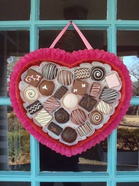 """DIY """"Box of Chocolates"""" Valentine Wreath for the front door...using crepe paper, foam core & styrofoam balls and paint...too cute!!"""