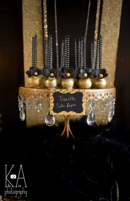 Glam gold and black cake pops with black bling sticks   Great Gatsby Dessert Table   http://doublefunparties.com/2014/08/04/guest-party-great-gatsby-dessert-table/