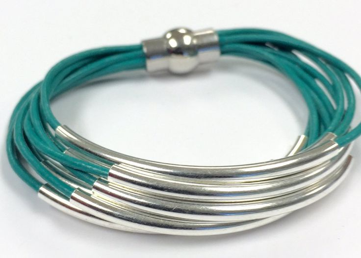 Leather tube bracelet has multiple strands of 1.5mm leather cords accented with moveable solid brass silver tube beads that are...
