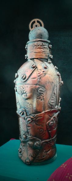 Faux Copper plate Steampunk bottle - polymer clay covered bottle