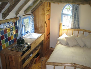 A higgledy-piggledy cottage on wheels offering a roomy four person stay.