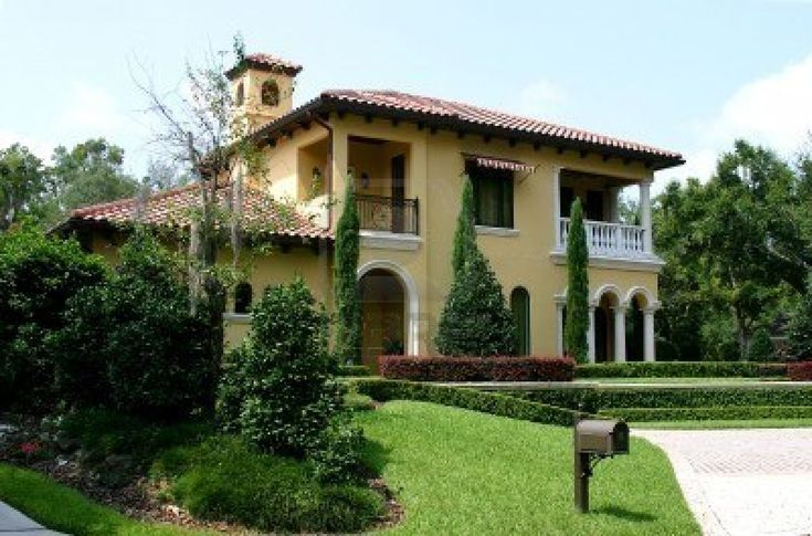 Upscale yellow spanish style stucco home with well for Spanish style homes for sale