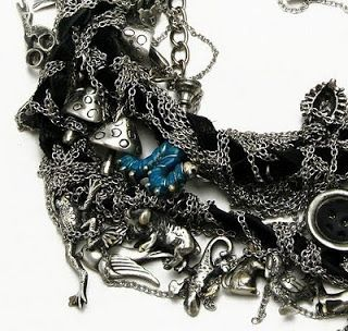 Tom Binn's Alice in Wonderland jewelry for Disney Couture ~ The Beading Gem's Journal. Double wrap suede bracelet draped in chains and charms.