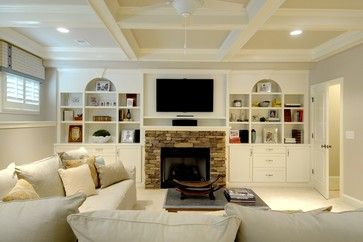 Beautiful built-ins in Georgia. Built-ins around the basement fireplace made this image worth saving to ideabooks. This wall couldve been left completely bare, but Houzz readers loved how the built-in shelves add life.