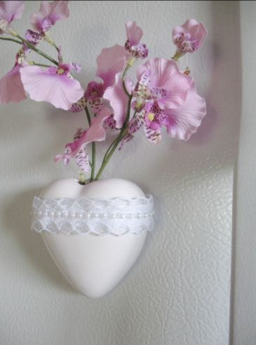 Mounted on a refrigerator with sticky-backed Velcro, this customized heart vase wedding favor becomes a gift that your guests will keep. Shown with silk orchids - but it's a real bud vase that can hold fresh flowers.