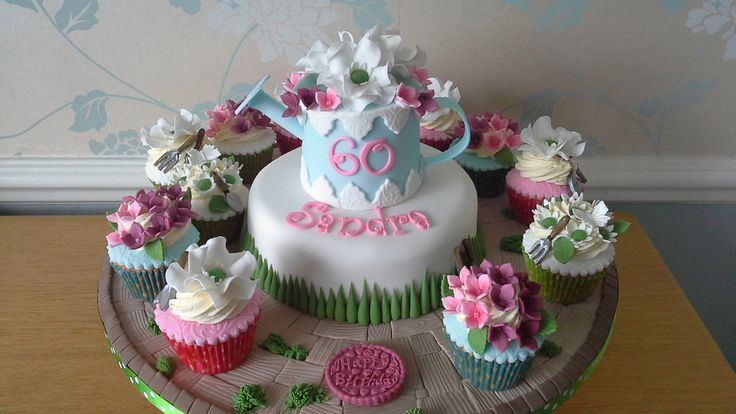 A beautiful cake full of flowers perfect for the lady whom just loves her garden