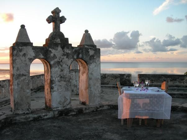 Private dining on the walls of the 16th century Portuguese Fort on Ibo Island off the coast of northern Mozambique, known as the Quirimbas Archipelago. Ibo Island has mangrove swamps teeming with birdlife, exquisite beaches, and a Zanzibarian flavour to the lodge. An exotic destination for honeymooners. Certainly this dining experience has bucket-loads of romantic ambiance, with wrap-around ocean views.