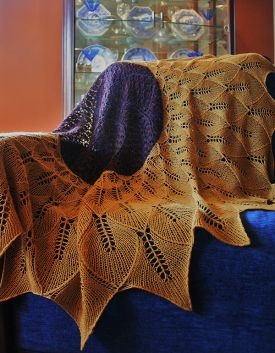 fabulous shawl, beautiful colours and lace! Tuscan Sunflower is a beautiful shawl knit in the round worked from the center to the edge and is comprised of six sections. The center motif utilizes double yarn overs on working rows and increases on resting rows. This charted pattern is very versatile. Using different materials and smaller needles you can have a beautiful table cloth; bigger needles, a lap blanket. http://www.knitpicks.com/patterns/tuscan-sunflower-shawl.html