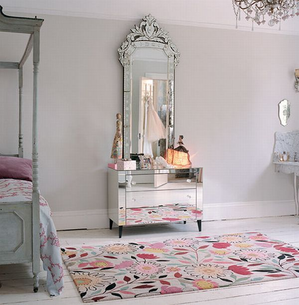 Beautiful venetian mirror sits on top of a mirrored vanity. Strong decoration...