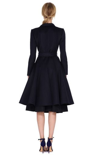 This navy overcoat from Oscar De La Renta features a notched collar, full length sleeves, full skirt and tonal waist sash.Hidden front snap closure60% orylag, 30% mohair, 10% cashgoraUnlinedMade in ItalyPlease note: This item is Final Sale.for credit or full refund.