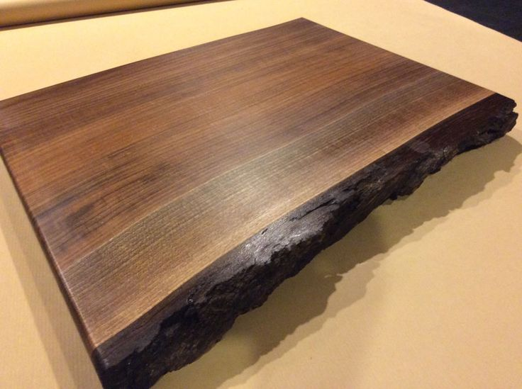 """Walnut cutting board with live edge, 20"""" x 14"""" x 1.75"""", priced at $90."""