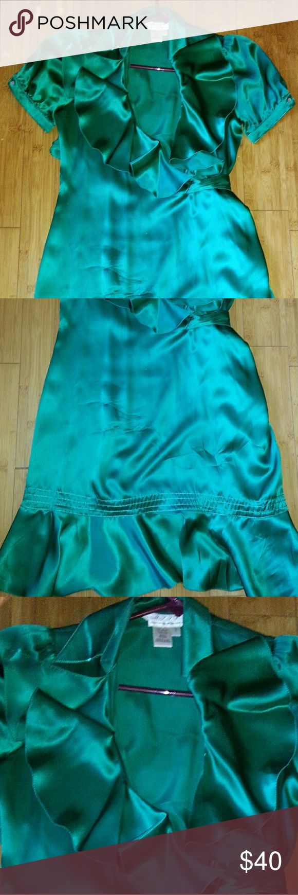Gorg green 100% silk wrap dress, worn once! Sz S/4 Gorg green 100% silk wrap dress, worn once! Sz S/4 Couture brand, will update but thght was Guess, but think higher end. Neimans for spring wedding, only time worn. Perfect! Be cute for night out on St Patties! Lush Dresses