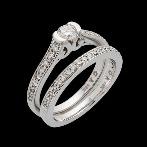 """""""Siena"""" is open on the side to showcase the center round brilliant diamond. This ring has a 0.25 carat round brilliant center diamond."""
