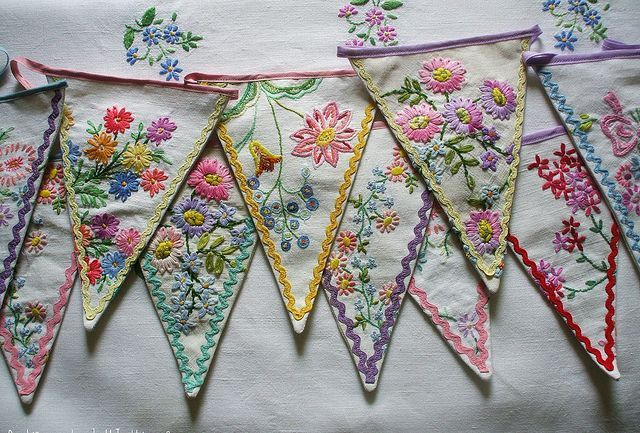 embroidered bunting from table cloths, pillowcases and such that have been too soiled /holey to use.