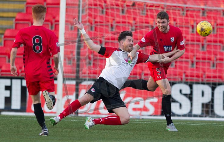 Queen's Park's Ryan McGeever heads clear during the SPFL League One play-off game between Clyde and Queen's Park.