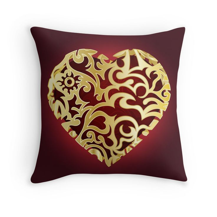 An openwork, ornate golden heart. Abstract