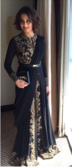 Bipasha Basu in a black with gold trim, saree-inspired dress by Sabyasachi.  Via Vogue.in