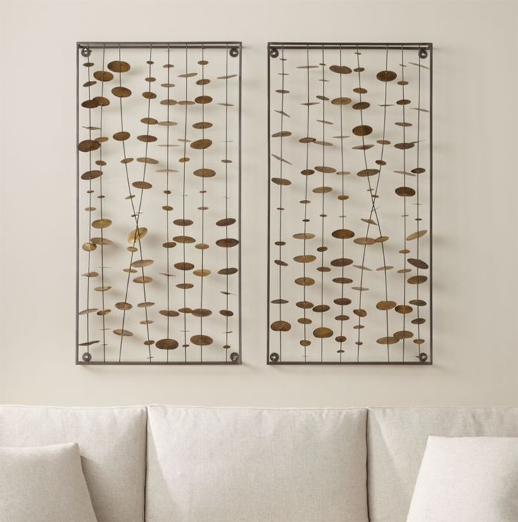 Set of 2 Chimes Metal Wall Sculptures, Crate and Barrel.  Inspired by traditional wind chimes, iron disks dotted with brass soldering cascade in this beautiful transitional modern art piece. Perfect above a sofa or entryway table. $199 each.