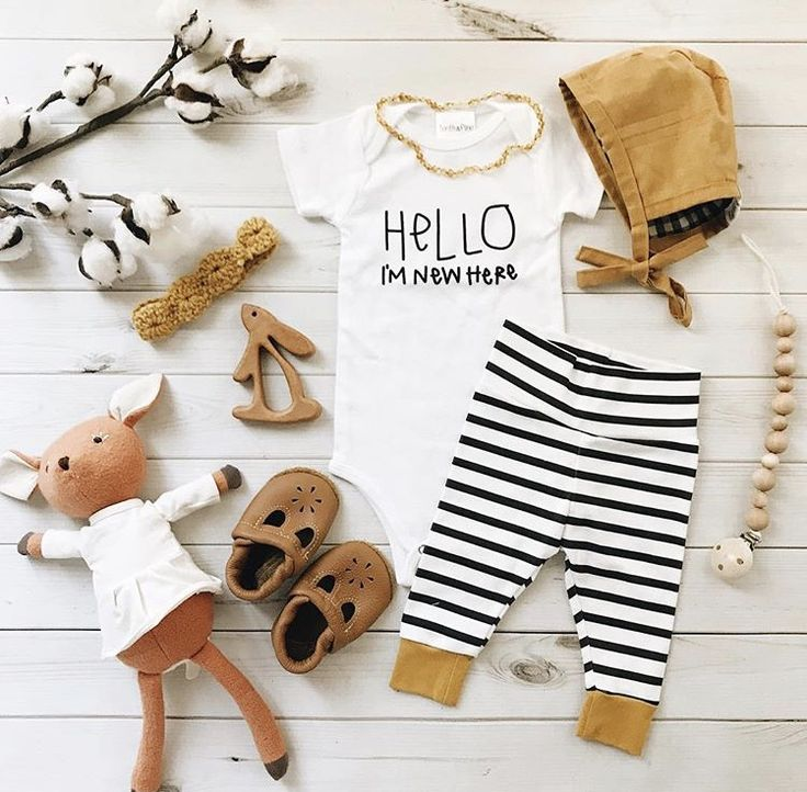Hello I'm new here. Hello world onesie onzie layette bodysuit. Baby boy girl newborn clothes outfit. Hospital going home outfit. Baby leggings organic cotton. Stripe leggings mustard yellow. Baby bonnet. Hazel village stuff animal. Leather Mary Janes moccasins. Teething baby toy. Wood pacifier clip. Amber teething necklace. Bunny toy. Baby flatlay. Fall spring summer kids fashion outfit ideas.figs and foxes