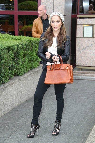 J.Lo in black leather jacket and jeggings with a light brown alligator-skin Birkin bag