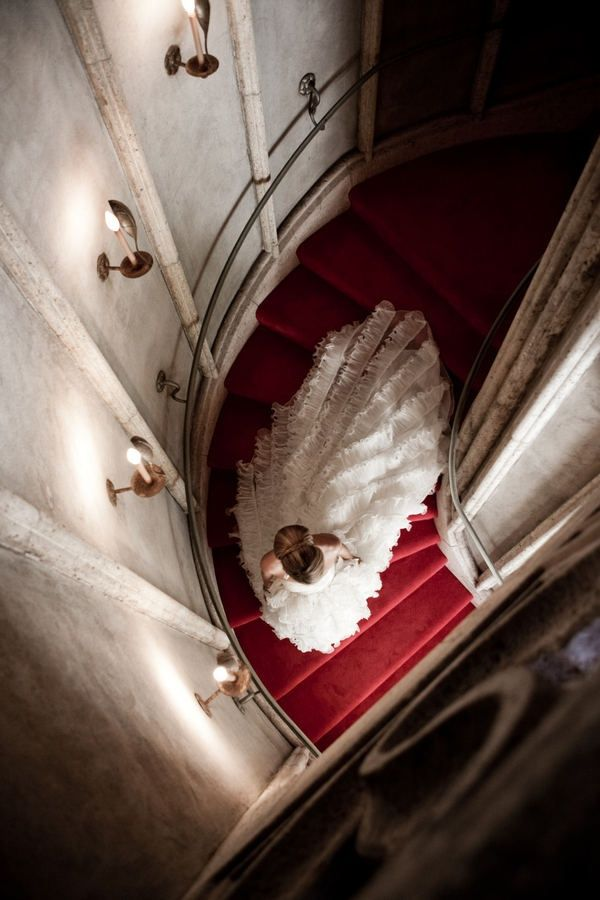 splendid shot of the bride at the staircase