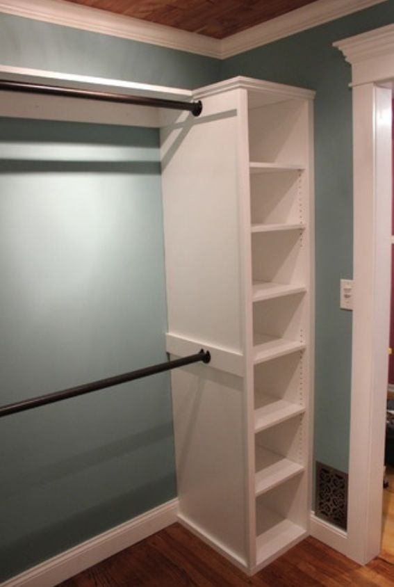 Great, inexpensive idea for a walk-in closet: a bookcase at each end of rods for the hanging clothes...