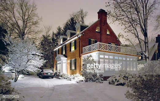 American traditional center hall colonial revival brick home with dormers.