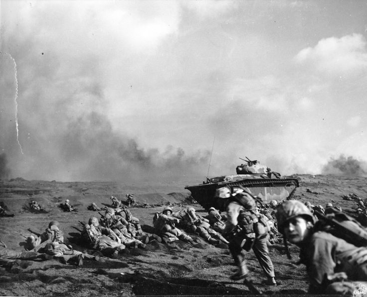 Launching the Assault, Iwo Jima, 1945. Photo caption: Iwo Jima February 19, 1945. A wave of Marines is organized after reaching the Iwo beachhead and preparations are made for the push inland. From the Photograph Collection at the Marine Corps Archives and Special Collections OFFICIAL USMC PHOTOGRAPH