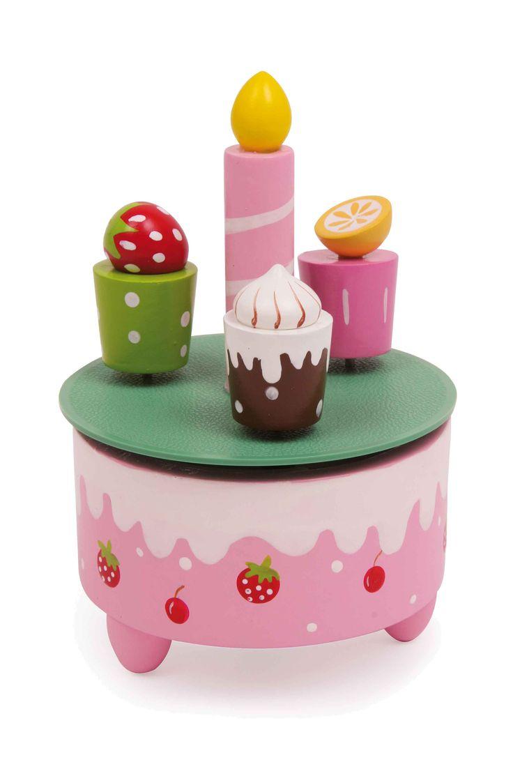 """Met de melodie van """"Happy Birthday"""" is dit speeluurwerk in de vorm van een verjaardagstaart een echte eyecatcher op iedere verjaardagstafel. Terwijl de kaars vast in het midden staat, draaien de kleine gebakjes er bont omheen."""