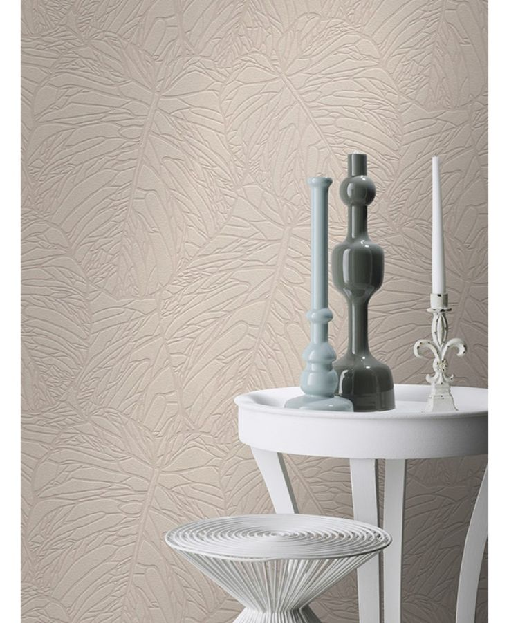 This Leaf Pattern Wallpaper in pale taupe and silver features a stunning cut out metallic tropical leaf design. Free UK delivery available