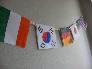 World Flags banner!  Fun to make in the time leading up to the Olympics, while learning a bit about each country you make flags for. Then during the opening ceremonies parade, you can find each country's flag as they come out.