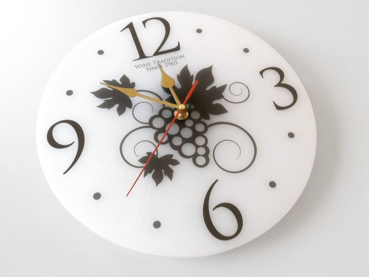 Black and white watch with grapes motif in plexiglass.