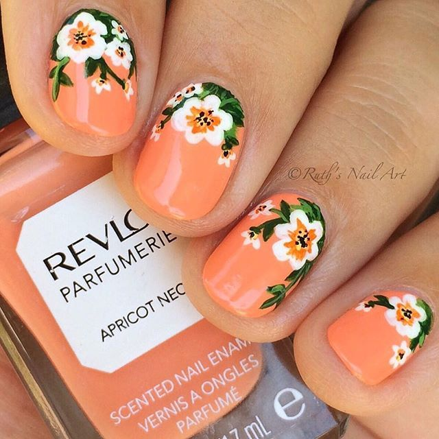 "As you know, I'm all about florals! These were painted with acrylic paint over ""Apricot Nectar"" by @revlon which smells amazing as do their other Parfumerie polishes. The smell of this one reminds me of creamsicles! Anyone else have trouble photographing peach nail polish? To me it's as tricky as neons. Anyways, I hope you like these!"
